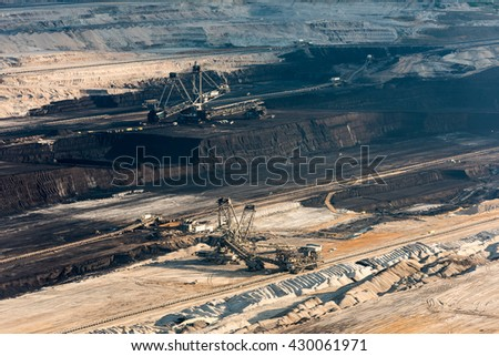 HAMBACH, GERMANY - MAY 19, 2016: Large machinery digging for brown-coal in of the world's deepest open-pit mines in Hambach in the Ruhr area in Germany. - stock photo