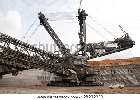 HAMBACH, GERMANY - SEPTEMBER 1: One of the world's largest bucket-wheel excavators digging coal in one of the world's deepest open-pit mines in Hambach on September 1, 2010 - stock photo