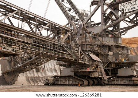 HAMBACH, GERMANY - SEPTEMBER 1: One of the world's largest bucket-wheel excavators digging for lignite (brown-coal) in of the world's deepest open-pit mines in Hambach on September 1, 2010 - stock photo