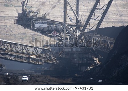 HAMBACH, GERMANY - SEPTEMBER 1: One of the world's largest bucket-wheel excavators digging lignite (brown-coal) in of the world's deepest open-pit mines in Hambach on September  1, 2010. - stock photo