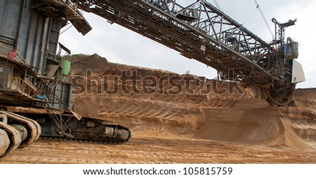 HAMBACH, GERMANY - SEPTEMBER 1: One of the world's largest excavators digging brown-coal (240,000 cubic metres per day) in one of the deepest open-pit mines in Hambach on September 1, 2010 - stock photo