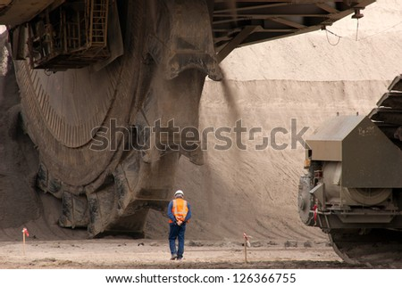 HAMBACH, GERMANY - SEPTEMBER 1: One of the world's largest excavators digging lignite in of the world's deepest open-pit mines in Hambach on September 1, 2010 - stock photo