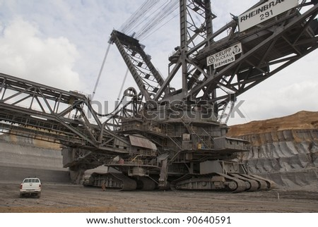 HAMBACH, GERMANY - SEPTEMBER 1, 2010: One of the world's largest excavators (225m) digging lignite (brown-coal) in one of the world's deepest open-pit mines in Hambach, Germany on September 1, 2010. - stock photo
