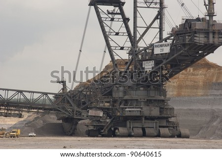 HAMBACH, GERMANY - SEPTEMBER 1, 2010: One of the world's largest excavators (225m) digging lignite (brown-coal) in one of the world's deepest open-pit mines in Hambach, Germany on September 1, 2010.