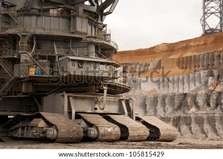 HAMBACH, GERMANY - SEPTEMBER 1: One of the world's largest excavators (225m) digging lignite (brown-coal) in one of the world's deepest open-pit mines in Hambach on September 1, 2010. - stock photo