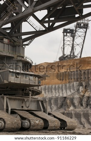 HAMBACH, GERMANY - SEPTEMBER 1: One of the world's largest excavators (225m) digging lignite (brown-coal) in one of the world's deepest open-pit mines in Hambach, Germany on September 1, 2010. - stock photo