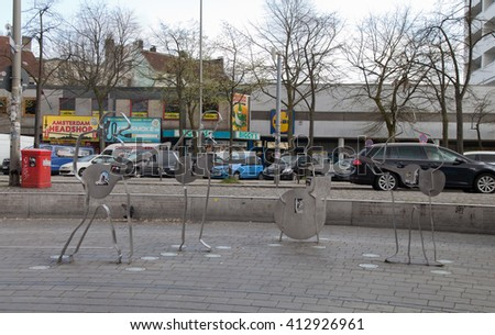 HAMBURG,GERMANY-APRIL 19,2016: Beatles Square (Beatles-Platz) at the corner of Reeperbahn and Gross Freiheit representing The Beatles at times during their Hamburg engagements. - stock photo