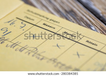 HAMBURG, GERMANY - APRIL 12 2015: German version of the International Certificate of vaccination for Measles, Mumps and Rubella (MMR) - stock photo