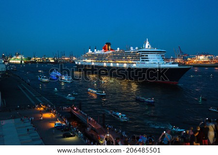 HAMBURG, GERMANY - August 19, 2014: Queen Mary 2, the luxurious Cunard Liner is visiting Hamburg for 10 years which is celebrated by a big parade on August 19, 2014 when leaving the harbour of Hamburg - stock photo
