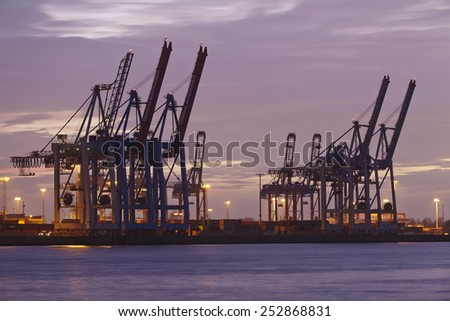 HAMBURG, GERMANY - FEBRUARY, 8. The Port of Hamburg (Germany) with container gantry cranes and terminals taken on February 8, 2015.