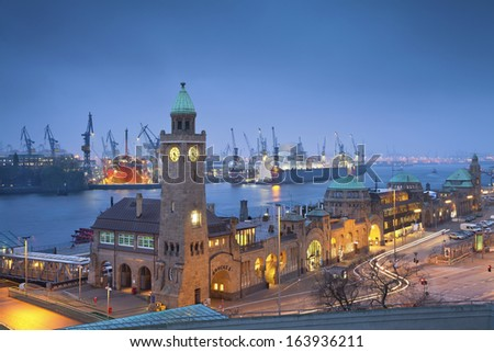 Hamburg, Germany. Image of Landungsbruecken and the harbor at night in Hamburg, Germany. - stock photo