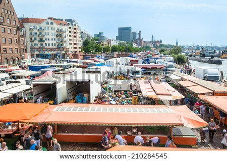 HAMBURG, GERMANY - JULY 20, 2014: People are enjoying the traditional Hamburg Fish Market in the early Sunday Morning on July 20, 2014 in Hamburg, Germany. The Fish Market is active since the 16th - stock photo