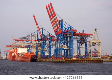 HAMBURG, GERMANY - JUNE 19, 2016:Container ships and feeder ships at the Container Terminal Altenwerder, Moorburg, Hamburg, Hamburg, Germany, Europe