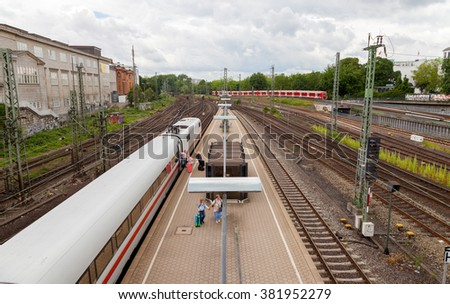 "HAMBURG, GERMANY - JUNE 2014: German inter city express ""ICE "" train from Deutsche Bahn, arrives at hamburg train station in june 2014."
