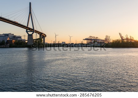 HAMBURG, GERMANY - JUNE 03. Koehlbrand bridge in the harbor of Hamburg on June 03, 2015. The bridge, opened, 1974 is an important Cable-stayed bridge and a landmark in the port The bridge is 315m high - stock photo