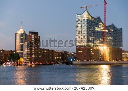 HAMBURG, GERMANY - JUNE 10. Night photograph from the office complex at the inner city island Kehrwieder and with the Elbe Philharmonic Hall as main attraction in Hamburg on June 10, 2015. - stock photo