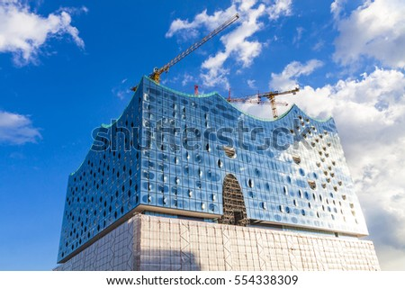 HAMBURG, GERMANY - JUNE 25,2014: The Elbphilharmonie, concert hall in the port of Hamburg. The tallest inhabited building of Hamburg, with a height of 110 metres. Announced opening date is 11 Jan 2017