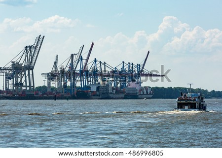 HAMBURG, GERMANY - JUNE 4, 2016: View of the Port of Hamburg and the Elbe river on June 4, 2016. It is Germanys largest port and is named the countrys Gateway to the World.