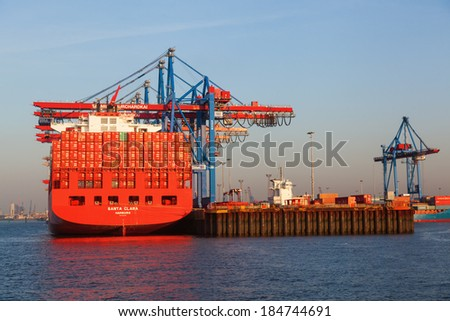 HAMBURG, GERMANY - MARCH 10: container ship Santa Clara of the Hamburg S�¼d shipping company in the Burchardkai on March 10, 2014. Burchardkai is the largest container terminal of the Hamurg port.