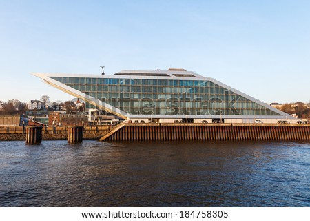 HAMBURG, GERMANY - MARCH 10: dockland viewd from the Elbe on March 10, 2014 in Hamburg. It is a futuristic office building in form of a parallelogram with a roof terrace and diagonal elevators. - stock photo