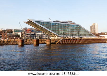 HAMBURG, GERMANY - MARCH 10: dockland viewd from the Elbe on March 10, 2014 in Hamburg. It is a futuristic office building in form of a parallelogram with a roof terrace and diagonal elevators.