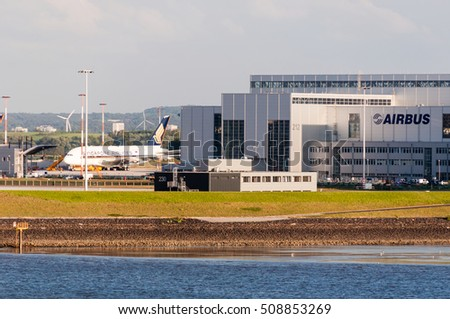 Hamburg, Germany - May 14, 2011: A Singapore Airlines plane is being fitted in front of the Airbus plant in Hamburg Finkenwerder. Airbus with its headquarters in Toulouse, France, is the largest