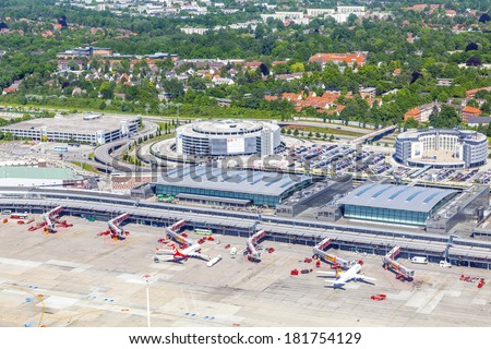 HAMBURG, GERMANY - MAY 24: aerial of Aircraft at the gate in Terminal 2 on May 24, 2012 in Hamburg, Germany. Terminal 2 was completed in 1993 and houses Lufthansa and other Star Alliance partners. - stock photo
