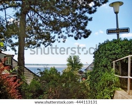 Hamburg, Germany - May 24, 2008: Hamburg district Blankenese, the exclusive residential area and suburb of the city. View between luxury houses in the hills towards river Elbe.