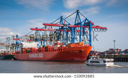 HAMBURG, GERMANY - MAY 1, 2013: Large container ships and a container terminals on May 1st, 2013. Hamburg harbor is Europe's second largest freight harbor.