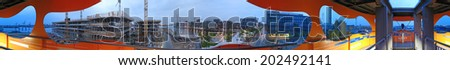 """HAMBURG, GERMANY - MAY 25, 2008: Panorama of the """"Hamburger Hafencity"""" on the move. The Hamburg-HafenCity consists of the lovely """"Speicherstadt"""", which attracts thousands of tourists each year.  - stock photo"""