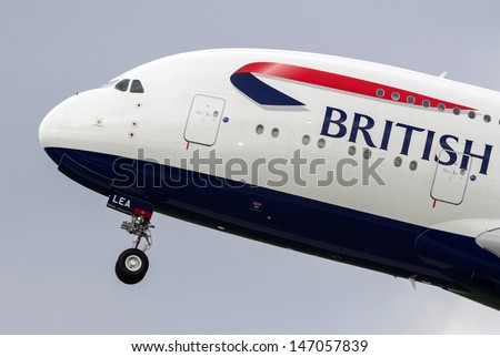 HAMBURG, GERMANY - MAY 24: Second Airbus A380 for British Airways leaves the airbus plant at hamburg finkenwerder for a test flight on May 24, 2013 - stock photo