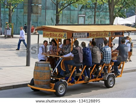 HAMBURG, GERMANY - MAY 21, 2011: The known Bierbike is shown on May 21, 2011 in Hamburg. You can sit here, drink beer and drive the the bike with your own feet. - stock photo
