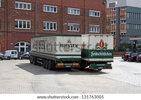HAMBURG, GERMANY - MAY 25, 2011: Two beer trucks at the Holsten brewery yard on May 25 2011 in Hamburg. Holsten Brewery was founded in 1879 in Hamburg and was acquired by the Carlsberg Group in 2004. - stock photo