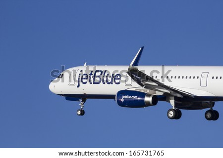 HAMBURG, GERMANY - NOVEMBER 13, 2013: A Brand new Airbus A321 for Jet Blue Airways leaves the Airbus Plant for its delivery flight to the US in Hamburg Finkenwerder on NOVEMBER 13, 2013.  - stock photo