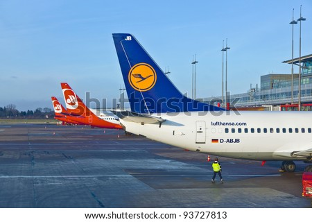 HAMBURG, GERMANY - OCT 26: Aircraft at the finger in the modern Terminal 2 on Oct 26, 2011 in Hamburg, Germany. Terminal 2 was completed in 1993 and houses Lufthansa and other Star Alliance partners.
