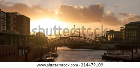 Hamburg harbour at sunset time - stock photo