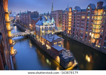 Hamburg- Speicherstadt. Image of Hamburg- Speicherstadt during twilight blue hour.  - stock photo