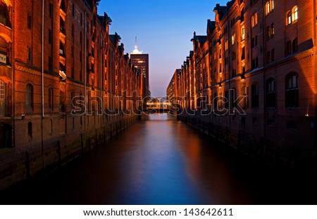 hamburg speicherstadt quarter with canal at night - stock photo