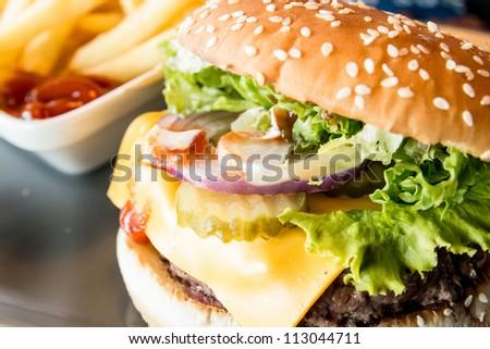 hamburger - American cheese burger with fresh salad - stock photo