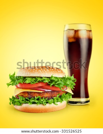 Hamburger and cola on a yellow background.