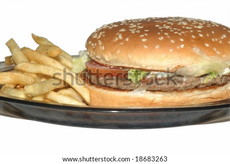 Hamburger and fries chips in a plate - stock photo