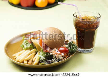 hamburger beef bacon egg french fries and Cola drink - stock photo