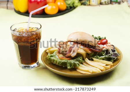 hamburger beef bacon egg french fries and salad with Cola drink  - stock photo