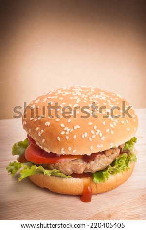 Hamburger closeup on brown background