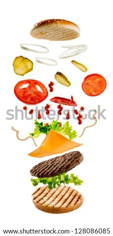 Hamburger - flying ingredients of hamburger - stock photo