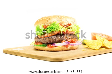 Hamburger, homemade, authentic hamburger with fresh vegetables, served on wooden plate isolated on white - stock photo