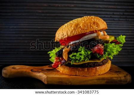 Hamburger, homemade hamburger with fresh vegetables - stock photo