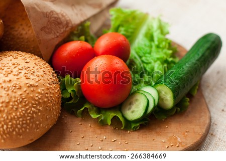 Hamburger ingredients on wood table - stock photo