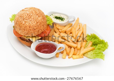 hamburger menu with fries and sauces on a plate - stock photo