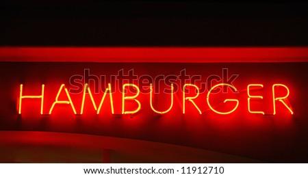 Hamburger neon sign hanging above a restaurant - stock photo